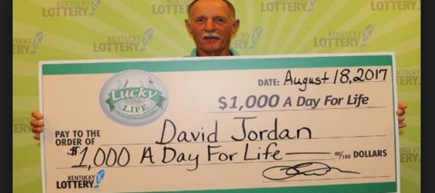 Winner claims the prize of $1,000 a day for life